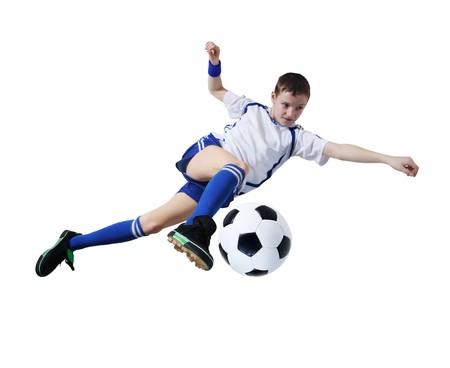 playing football: Chico con bal�n de f�tbol, futbolista sobre el fondo blanco. (aislado)