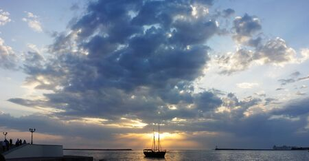 silhouette of the yacht at sunset, nature photo