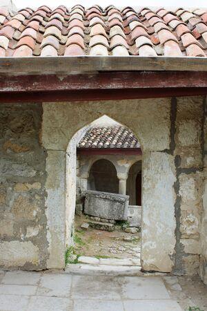 Old stone gate of the courtyard Chufut-kale, Bakhchisaray, Crimea, Ukraine XIV centuries Stock Photo - 7178248