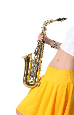 Girl with a sax musical instrument on tne white background photo