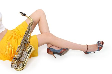 Womens long sitting with sax on tne white background  photo