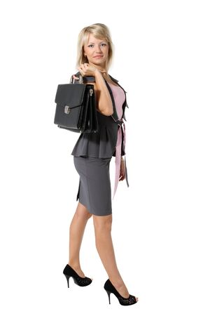 Young beautiful girl, a businesswoman with a briefcase on the white background Stock Photo - 7536380