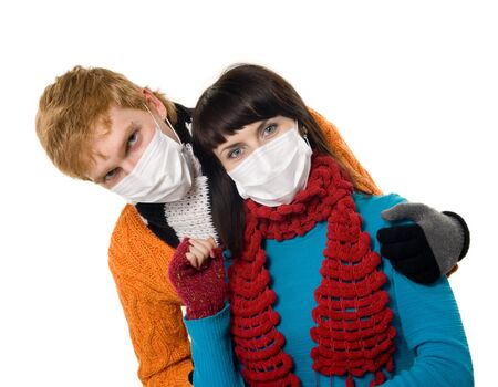 ah1n1: man embraces a woman wearing masks, flu, A(H1N1), on the white grey background Stock Photo