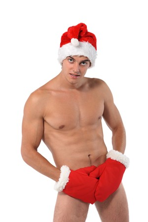 Sexy muscular man wearing a Santa Claus hat isolated on white Stock Photo - 7860731