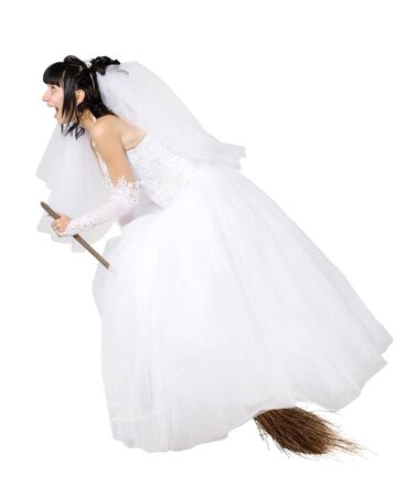 bride in white wedding dress on a broom, on the white photo