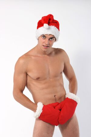 Sexy muscular man wearing a Santa Claus hat isolated on white Stock Photo - 7940752