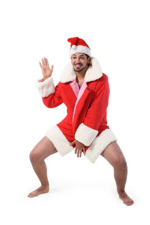 Sexy muscular man wearing a Santa Claus hat isolated on white Stock Photo - 7940751