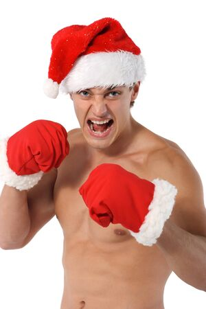 sexy muscular man: boxer Sexy muscular man wearing a Santa Claus hat isolated on white Stock Photo