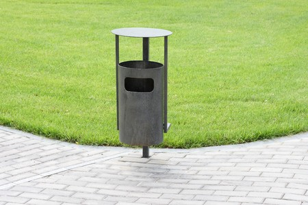 Green grass, refuse bin Stock Photo - 8142178