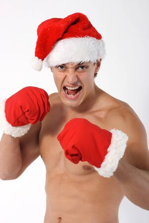 boxer Sexy muscular man wearing a Santa Claus hat isolated on white photo