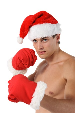 Sexy muscular man boxer wearing a Santa Claus hat isolated on white Stock Photo - 8246806