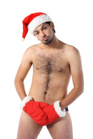 Sexy muscular man wearing a Santa Claus hat isolated on white Stock Photo - 8246882