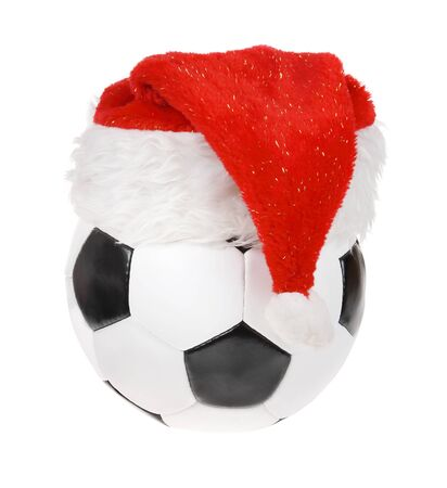 Santa Claus hat on the soccer ball on the white background. (isolated) photo