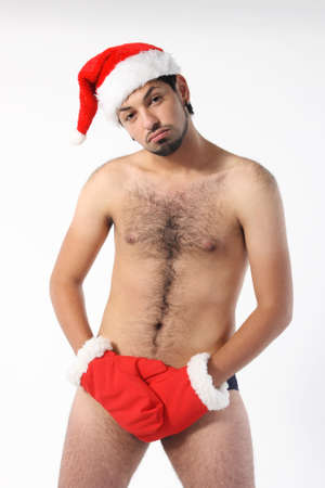 Sexy muscular man wearing a Santa Claus hat isolated on white Stock Photo - 8319488