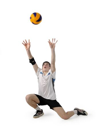 Volleyball player with the ball on a white background