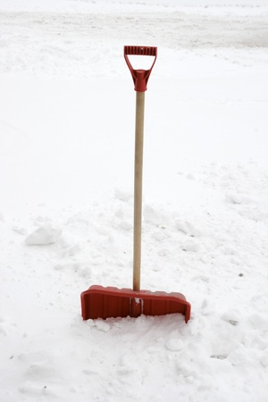 plows: red snow showel burried in heavy snow  Stock Photo