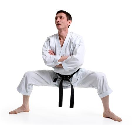 Karate. Man in a kimono with a white background Stock Photo - 8791106
