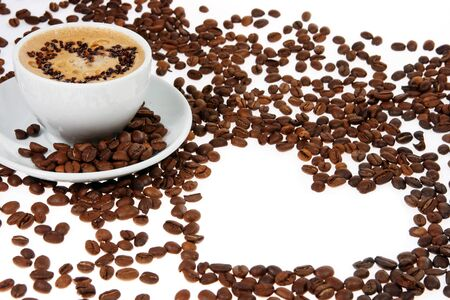 coffee mug against the backdrop of coffee beans photo