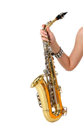 Saxophone in the womens hand on the white background photo