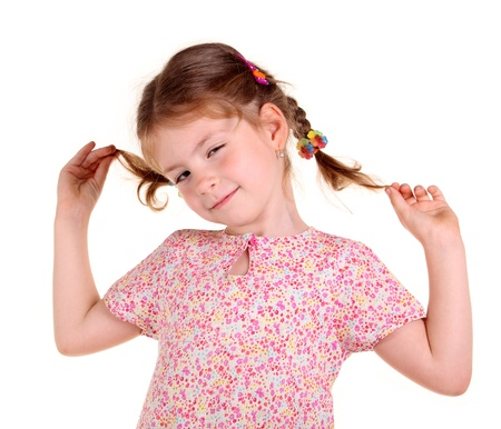 Little girl with braids on the white background photo