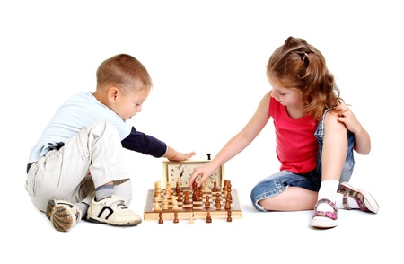 Children playing chess on the white background Stock Photo