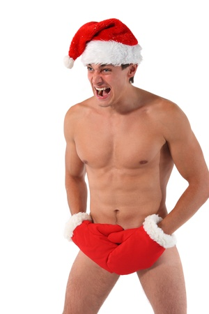 Sexy muscular man screams wearing a Santa Claus hat isolated on white photo