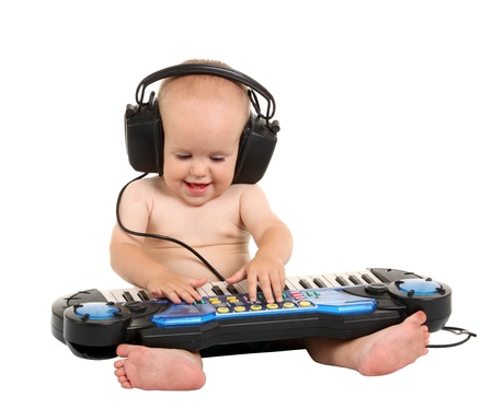 Little boy in headphones on the white background Imagens