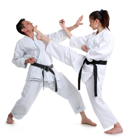 jujitsu: Karate. Young girl and a men in a kimono with a white background. Battle sports capture