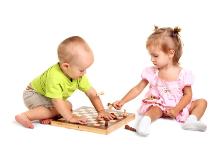 Children playing chess on the white background photo