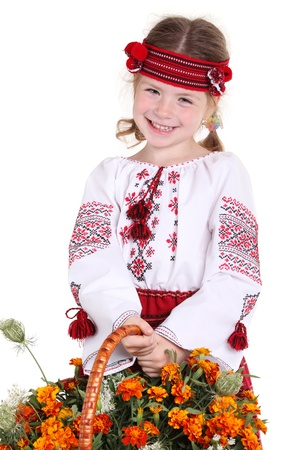 national holiday: Little girl in the national Ukrainian costume on the white background