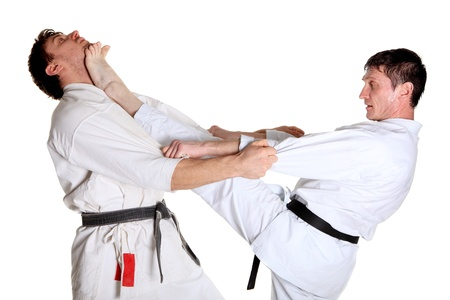 jujitsu: Karate. Men in a kimono with a white background. Battle sports capture