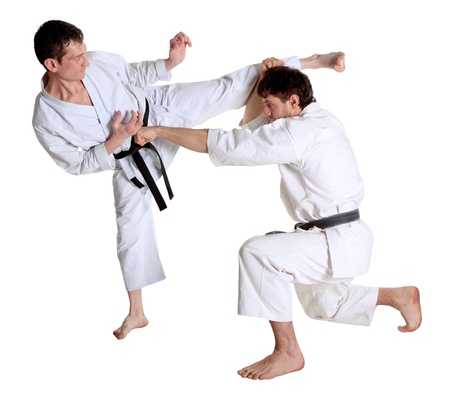 Karate. Men in a kimono with a white background. Battle sports capture Stock Photo - 12476897