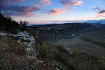 sunrise in the mountains  Cave city Eski-Kermen, Crimea, Ukraine VI-XIV centuries photo