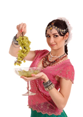 Young girl in the Indian national dress with grapes photo