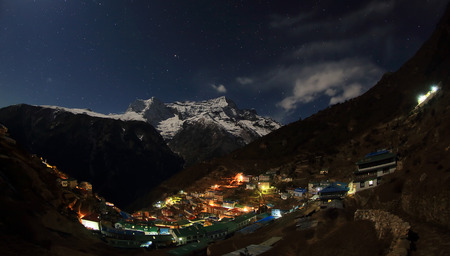 ri: Night sky and stars passing by behind mountain Kongde Ri, Namche Bazaar village. Nepal