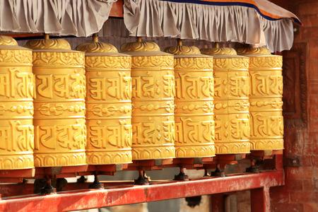 Buddhist prayer wheels. Swayambhunath Stupa, Kathmandu, Nepal photo
