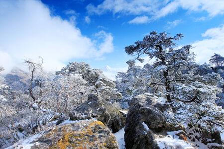 ri: Movement of the clouds on the mountains Kongde Ri, Himalayas, Nepal Stock Photo
