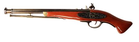 Model of the old gun on the white background, souvenir photo