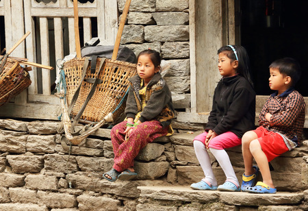 HIMALAYAS, NEPAL, MARCH 20: Nepalese children near the house. Everest region, Himalayas, in Nepal on March 20, 2014