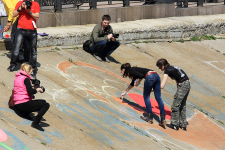 9 11: DONETSK - APRIL 11: Group of artists painted on the waterfront Easter basket in Donetsk. April 9, 2015