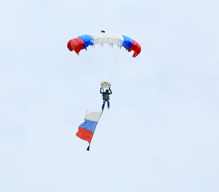 russia steppe: ROSTOV REGION, RUSSIA - APRIL 18: Parachutist with the flag of Russia. International Festival of ecological tourism Celebrated steppe in Rostov region, Russia. April 18, 2015.