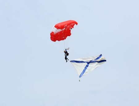 russia steppe: ROSTOV REGION, RUSSIA - APRIL 18: Parachutist with Naval flag of Russia. International Festival of ecological tourism Celebrated steppe in Rostov region, Russia. April 18, 2015. Editorial