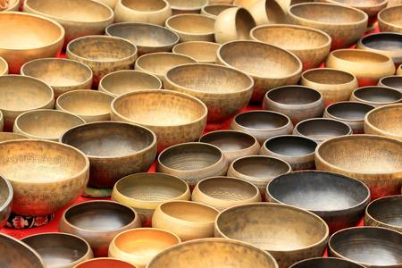 singing bowls: Older Nepalese musical instrument on the market, background