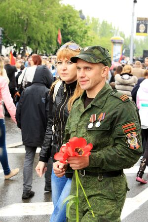 immortal: DONETSK - MAY 9, 2015:  Victory Parade in Donetsk. Immortal regiment. May 9, 2015