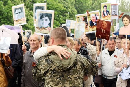regiment: DONETSK - MAY 9, 2015:  Victory Parade in Donetsk. Immortal regiment. May 9, 2015