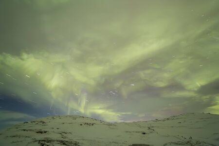 starry night: Northern Lights on the Kola Peninsula. Teriberka, Murmansk region, Russia.