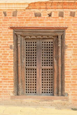 Old carved wooden door, background. Nepal.