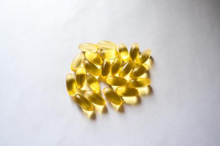 Handful of evening primrose oil supplement capsules Stock Photo