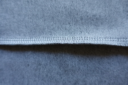 Stitch on the inner side of grey fabric Stock Photo