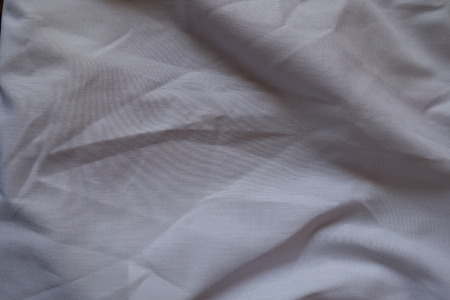 Crumpled plain cotton fabric directly from above